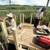 BEN GARVER — THE BERKSHIRE EAGLE<br /> Peter Jensen and Eddy Ryan build an observation deck on Parsons Marsh for the Berkshire Natural Resources Council in Lenox, Thursday, September 13, 2018. The 1800 foot trail is accessible to all.
