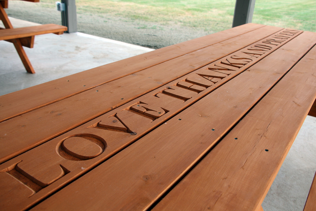 HALEE HEIRONIMUS / GAZETTE Phrases, Bible verses and family names are among the messages engraved in 24 picnic tables inside the newly dedicated Dunphy-Waldron pavilion outside of St. Martin of Tours Catholic Church in Liverpool Township.