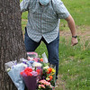 Scene of fatality on Pawtucket Boulevard in Lowell near the former MA/COM building, where Jose and Fernanda Medina were killed while walking on the sidewalk by a vehicle that veered off the road. Family members including Joe Rosa of Tewksbury, arrive with flowers and spend about half an hour, ending by gathering in a circle for a prayer Saturday afternoon. (SUN/Julia Malakie)