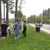 Scene of fatality on Pawtucket Boulevard in Lowell near the former MA/COM building, where Jose and Fernanda Medina were killed while walking on the sidewalk by a vehicle that veered off the road. Family members arrive with flowers and spend about half an hour, ending by gathering in a circle for a prayer Saturday afternoon.(SUN/Julia Malakie)