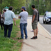 Scene of fatality on Pawtucket Boulevard in Lowell near the former MA/COM building, where Jose and Fernanda Medina were killed while walking on the sidewalk by a vehicle that veered off the road. Family members talk during a visit to the scene Saturday afternoon. (SUN/Julia Malakie)