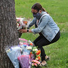 Scene of fatality on Pawtucket Boulevard in Lowell near the former MA/COM building, where Jose and Fernanda Medina were killed while walking on the sidewalk by a vehicle that veered off the road. Family members including niece Melissa Boucher, adding a bouquet, arrive with flowers and spend about half an hour, ending by gathering in a circle for a prayer Saturday afternoon. (SUN/Julia Malakie)