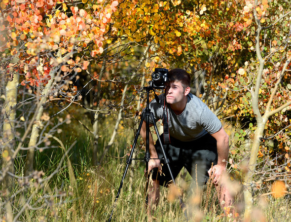 "Patrick Orme, of Denver, takes a photograph of the changing fall foliage on the Peak to Peak Scenic Byway near Nederland. For more photos and video of the changing colors go to  <a href=""http://www.dailycamera.com"">http://www.dailycamera.com</a><br /> Jeremy Papasso/ Camera"