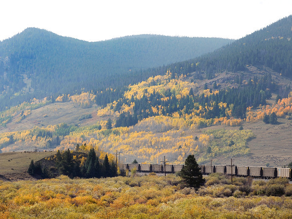 "A train sits below the fall foliage on county road 16 near Nederland. For more photos and video of the changing colors go to  <a href=""http://www.dailycamera.com"">http://www.dailycamera.com</a><br /> Jeremy Papasso/ Camera"