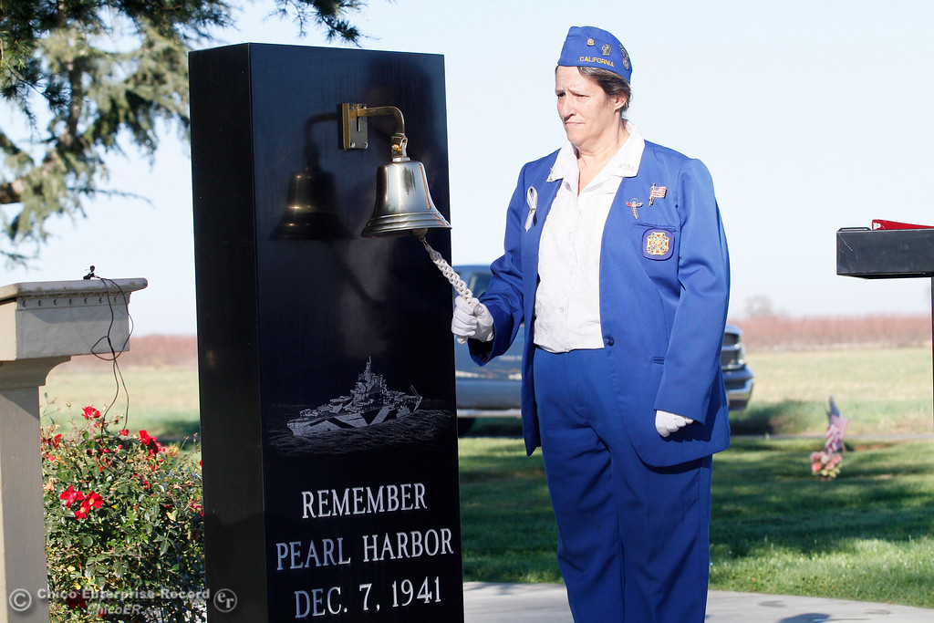 . Chaplain Jeanette Hayhurst rings the bell during the Pearl Harbor remembrance ceremony Thursday, Dec. 7, 2017, at the Gridley Cemetery in Gridley, California. (Dan Reidel -- Enterprise-Record)