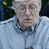 Art Wells, 95, of Chico, takes a look at the photo of his wife that he has kept in his wallet for more than 6 decades just before the Pearl Harbor remembrance ceremony Thursday, Dec. 7, 2017, at the Gridley Cemetery in Gridley, California. (Dan Reidel -- Enterprise-Record)