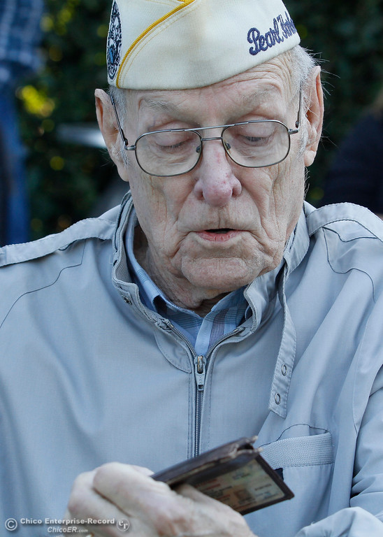 . Art Wells, 95, of Chico, takes a look at the photo of his wife that he has kept in his wallet for more than 6 decades just before the Pearl Harbor remembrance ceremony Thursday, Dec. 7, 2017, at the Gridley Cemetery in Gridley, California. (Dan Reidel -- Enterprise-Record)