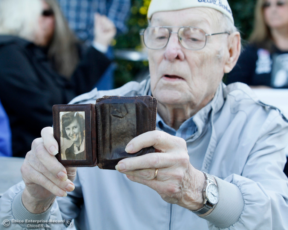 . Pearl Harbor survivor Art Wells shows off a photo of his wife Dolores just before the Pearl Harbor remembrance ceremony Thursday, Dec. 7, 2017, at the Gridley Cemetery in Gridley, California. (Dan Reidel -- Enterprise-Record)