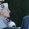 Art Wells, 95, of Chico, left, speaks to a representative of Rep. Doug LaMalfa's office (not pictured) as Chico VFW Post Commander Mike Halldorson looks on just before the Pearl Harbor remembrance ceremony Thursday, Dec. 7, 2017, at the Gridley Cemetery in Gridley, California. (Dan Reidel -- Enterprise-Record)