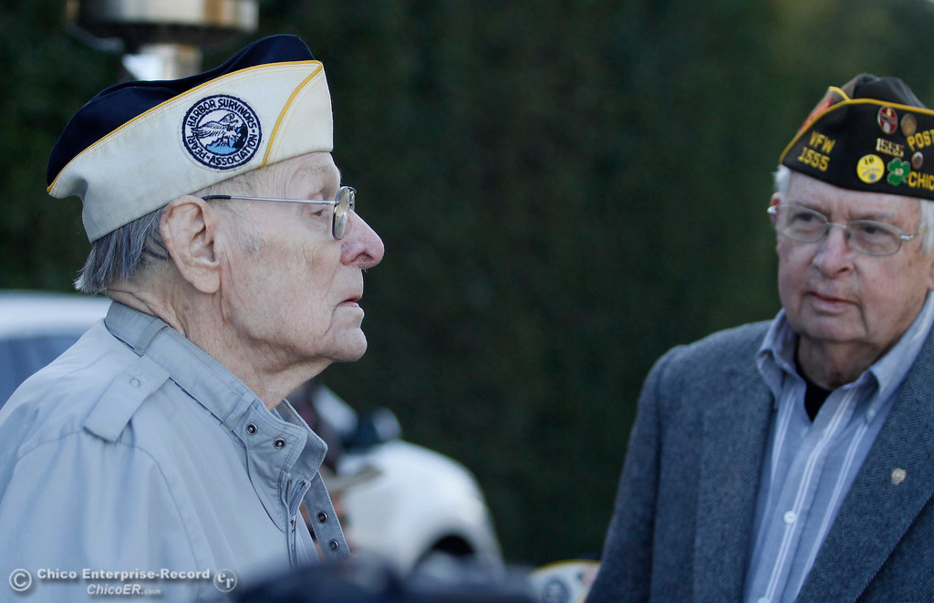 . Art Wells, 95, of Chico, left, speaks to a representative of Rep. Doug LaMalfa\'s office (not pictured) as Chico VFW Post Commander Mike Halldorson looks on just before the Pearl Harbor remembrance ceremony Thursday, Dec. 7, 2017, at the Gridley Cemetery in Gridley, California. (Dan Reidel -- Enterprise-Record)