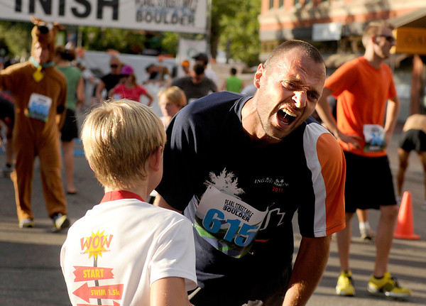 "Jevgenij Cariov, of Boulder, tries to catch his breath after running the Family Race on Thursday, Aug. 11, during the Pearl Street Mile for the 2011 Run Boulder Series. For more photos of the race go to  <a href=""http://www.dailycamera.com"">http://www.dailycamera.com</a><br /> Jeremy Papasso/ Camera"