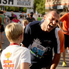 """Jevgenij Cariov, of Boulder, tries to catch his breath after running the Family Race on Thursday, Aug. 11, during the Pearl Street Mile for the 2011 Run Boulder Series. For more photos of the race go to  <a href=""""http://www.dailycamera.com"""">http://www.dailycamera.com</a><br /> Jeremy Papasso/ Camera"""