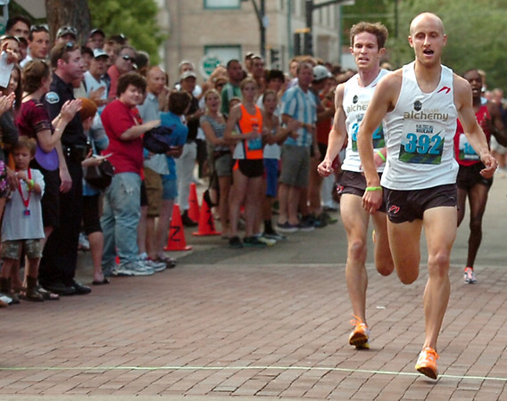 "Team Alchemy's Kenyon Newman, right, and his teammate Jeremy Freed, lead the pack while racing in the Mens Competitive class on Thursday, Aug. 11, during the Pearl Street Mile race for the 2011 Run Boulder Series. Newman took first place and Freed took second.<br /> For more photos of the race go to  <a href=""http://www.dailycamera.com"">http://www.dailycamera.com</a><br /> Jeremy Papasso/ Camera"