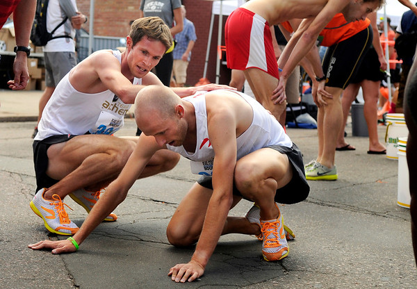 """Team Alchemy's Kenyon Newman, center, gets some help from his teammate Jeremy Freed after winning the Mens Competitive class race on Thursday, Aug. 11, during the Pearl Street Mile race for the 2011 Run Boulder Series. Freed took second place in the Mens Competitive class. For more photos of the race go to  <a href=""""http://www.dailycamera.com"""">http://www.dailycamera.com</a><br /> Jeremy Papasso/ Camera"""