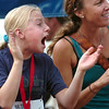 "Olivia Straka, 11, cheers for her father during the Mens Competitive class race on Thursday, Aug. 11, during the Pearl Street Mile race for the 2011 Run Boulder Series. For more photos of the race go to  <a href=""http://www.dailycamera.com"">http://www.dailycamera.com</a><br /> Jeremy Papasso/ Camera"