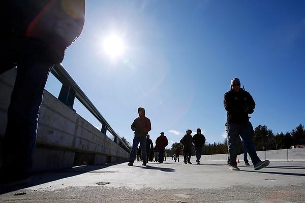 Pedestrians walk across Brattleboro I-91 bridge-030417