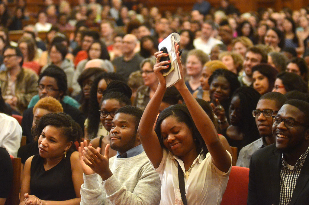 . A packed auditorium reacts to to political activist and scholar Angela Davis as she presents a lecture titled, \'Leadership in the 21st Century,\' in Chapin Hall at Williams College on Saturday, April, 12, 2014. Gillian Jones / Berkshire Eagle Staff / photos.berkshireeagle.com
