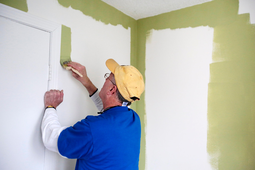 . Mayor Daniel Bianchi joins AmeriCorps VISTA and the Retired Senior Volunteer Program (RSVP) in painting a room at the Central Berkshire Habitat for Humanity office in Pittsfield as he participates in the Mayors Day of Recognition for National Service. Tuesday, April 1, 2014. Stephanie Zollshan / Berkshire Eagle Staff / photos.berkshireeagle.com
