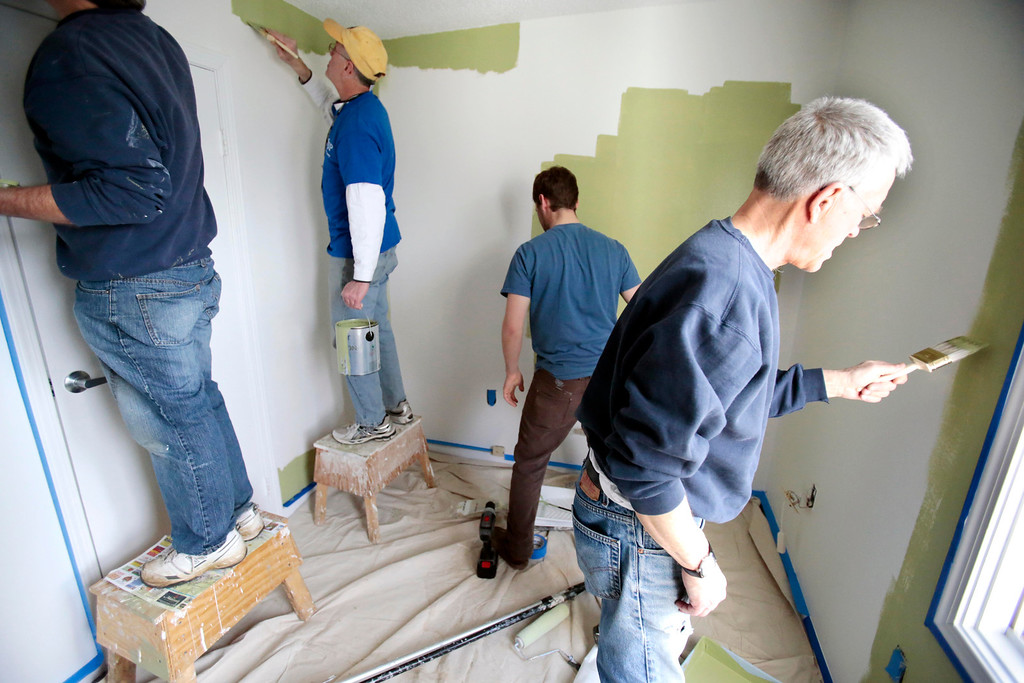. Mayor Daniel Bianchi, center left, joins AmeriCorps VISTA and the Retired Senior Volunteer Program (RSVP) in painting a room at the Central Berkshire Habitat for Humanity office in Pittsfield as he participates in the Mayors Day of Recognition for National Service. Tuesday, April 1, 2014. Stephanie Zollshan / Berkshire Eagle Staff / photos.berkshireeagle.com