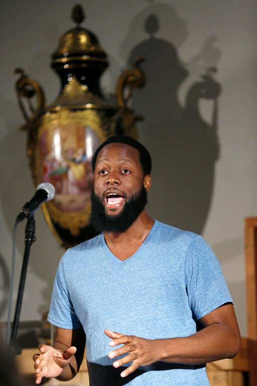 . Guest poet Jive Poetic performs his poems as the results are being tallied after the WordXWord storytelling finals at the Berkshire Museum in Pittsfield at the end of the week of WordXWord performances and workshops. Friday, August 22, 2014. Stephanie Zollshan / Berkshire Eagle Staff / photos.berkshireeagle.com