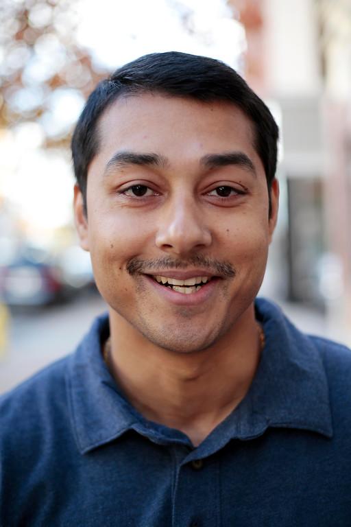 . Sumi Basnet sports his \'Movember\' moustache in Pittsfield. Friday, November 8, 2013. (Stephanie Zollshan | Berkshire Eagle Staff)