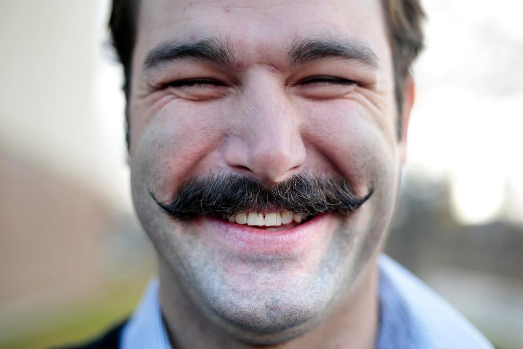 . James Hespeler, a P.E. teacher at Conte Community School in Pittsfield, shows off his \'Movember\' moustache. Friday, November 8, 2013. (Stephanie Zollshan | Berkshire Eagle Staff)