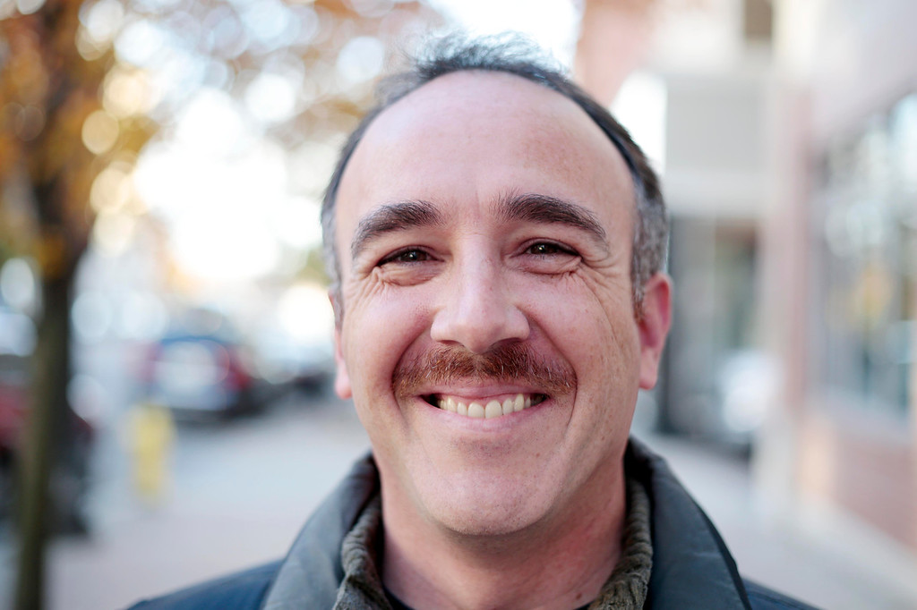 . Mike Trainor sports his \'Movember\' moustache in Pittsfield. Friday, November 8, 2013. (Stephanie Zollshan | Berkshire Eagle Staff)