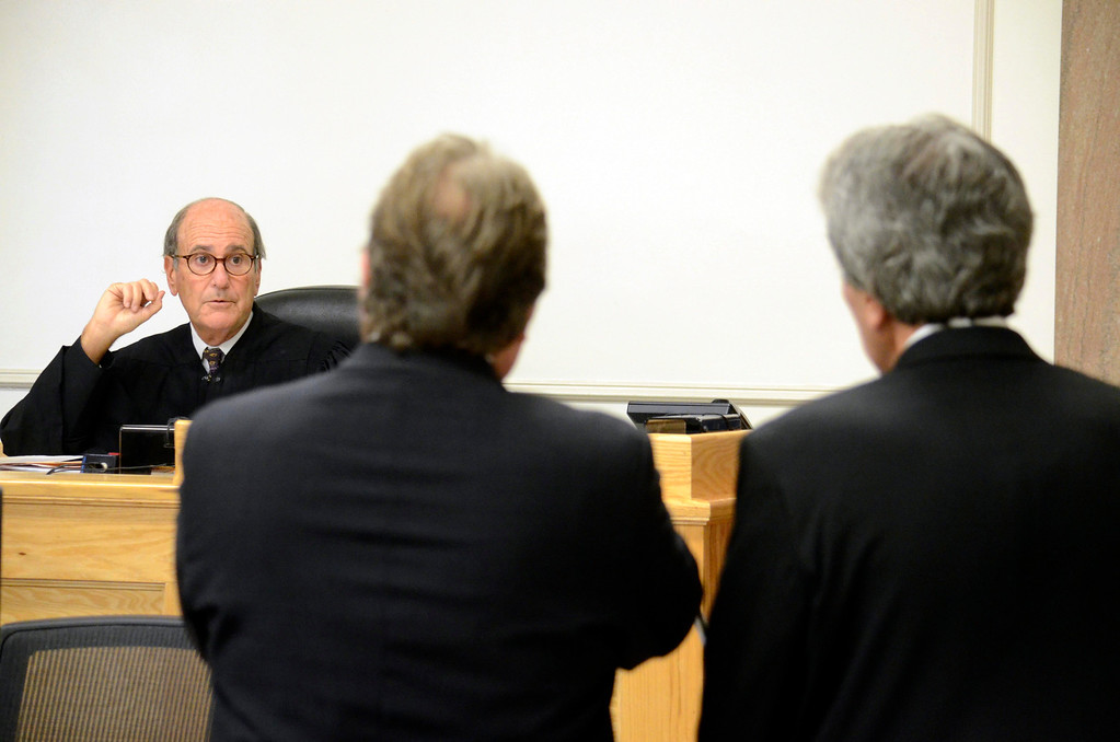 . District Judge Fredric Rutberg speaks to attorney Timothy Shugrue and Paul Capitanio (right) during Capitanio\'s arraignment on drug related charges.  Tuesdau August 20, 2013. Ben Garver / Berkshire Eagle Staff