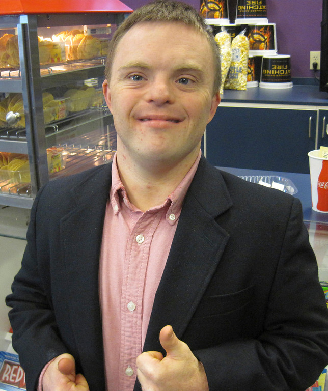 """. Peter Johnson, 26, of Scituate and West Stockbridge gives two thumbs-up after a North Adams Movieplex screening of the 2007 family holiday film \""""The Child King,\"""" in which Johnson is cast in a leading role. Jenn Smith/Berkshire Eagle Staff Saturday, Nov. 9, 2013"""