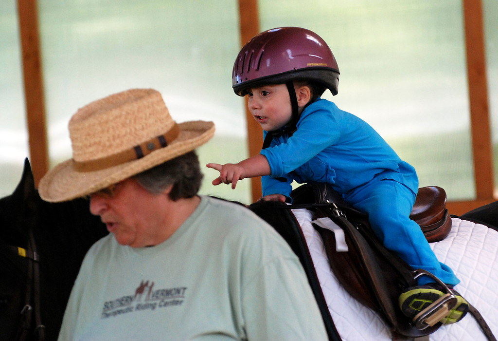 . Kayla Rice/Reformer                                 Lexi Leland, 3, works on exercises during her weekly horse therapy at Winchester Stables in Newfane.