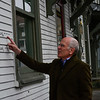 KRISTOPHER RADDER - BRATTLEBORO REFORMER<br /> U.S. Rep. Peter Welch, D-Vt., looks at the high water level mark from the 2011 flood during a visit on Wednesday, April 4, 2018.