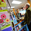 KRISTOPHER RADDER - BRATTLEBORO REFORMER<br /> U.S. Representative Peter Welch, D-Vt., meets with Ana McDaniel, manager at Bartleby's Books, during a tour of downtown Wilmington on Wednesday, April 4, 2018.