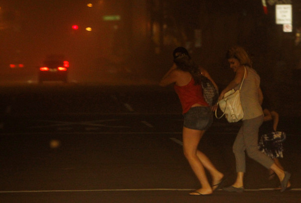 PhoenixDust Storm.JPEG-039e.JPG Pedestrians run to cross the street as they try to get away from a dust storm in downtown Phoenix, Tuesday, July 5, 2011.   A massive dust storm has swept into the Phoenix area and drastically reduced visibility across much of the valley.   (AP Photo/Ross D. Franklin)