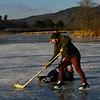 KRISTOPHER RADDER — BRATTLEBORO REFORMER<br /> Eric Solomon skates around a makeshift goal during a pick-up ice hockey game at the Retreat Meadows on Wednesday, Dec. 12, 2018.