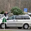 BEN GARVER — THE BERKSHIRE EAGLE<br /> A family ties a Christmas tree to the roof of their car at Ioka Valley Farm in Hancock,  Mass., Friday, November 29, 2019.