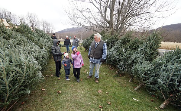 BEN GARVER — THE BERKSHIRE EAGLE<br /> Brian Hoskeer shares a moment with his grandchildren while looking for a Christmass tree  at Ioka Valley Farm in Hancock,  Mass., Friday, November 29, 2019.