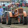 A driver takes his turn atop an Allis-Chalmers tractor during the antique tractor pull at the Pioneer Power Show Saturday. Photo by Pat Christman