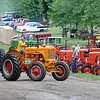 Tractors make their way around the Pioneer Power Show grounds Saturday. Photo by Pat Christman