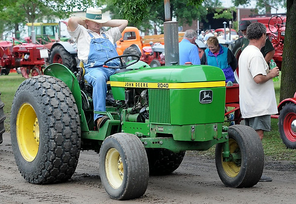 A man takes a rest while waiting for the tractor parade to start at the Pioneer Power Show Saturday. Photo by Pat Christman