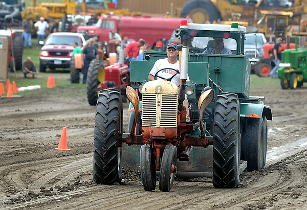 Mark Kelly guides his tractor down the strip during the antique tractor pull at the Pioneer Power Show Saturday near Le Sueur. Photo by Pat Christman