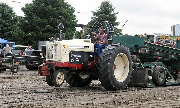 """Dick Olson drives his tractor """"Grandma's Toy"""" during the antique tractor pull Saturday. Photo by Pat Christman"""