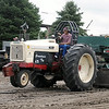 "Dick Olson drives his tractor ""Grandma's Toy"" during the antique tractor pull Saturday. Photo by Pat Christman"