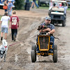 Jeff Nelson takes his dogs Oliver (on his lap) and Pepper for a walk around the Pioneer Power Show Saturday. Photo by Pat Christman