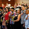 BEN GARVER — THE BERKSHIRE EAGLE<br /> Students from the Pittsfield Adult Learning Center listen to the National Anthem before graduation, Thursday, June 13, 2019.