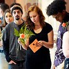 BEN GARVER — THE BERKSHIRE EAGLE<br /> Charlynn Rand, 19, glances at a flower given to her before graduating from the Pittsifield Adult Learning Center, Thursday, June 13, 2019.