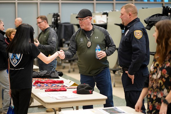 BEN GARVER — THE BERKSHIRE EAGLE<br /> Pittsfield officer Steve Hunt of the crime unit speaks to  a student about working on the police force at Taconic High School during the police expo, Tuesday, January 8, 2019.