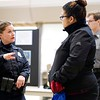 BEN GARVER — THE BERKSHIRE EAGLE<br /> Pittsfield officer Jessica Godfroy talks with Caridalys Garcia about working on the police force at Taconic High School during a police expo, Tuesday, January 8, 2019.