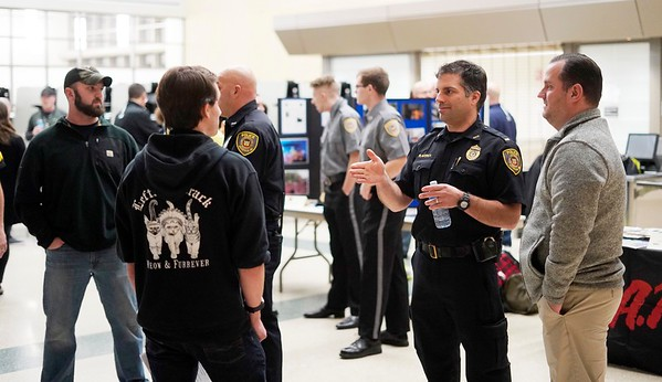 BEN GARVER — THE BERKSHIRE EAGLE<br /> Pittsfield Police Lieutenant Gary Traversa chats about his job at Taconic High School during a police expo, Tuesday, January 8, 2019.
