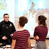 BEN GARVER — THE BERKSHIRE EAGLE<br /> Pittsfield officer Nicholas Cabral talks with Taconic Students about the police academy and working on the police force at Taconic High School during the police expo, Tuesday, January 8, 2019.