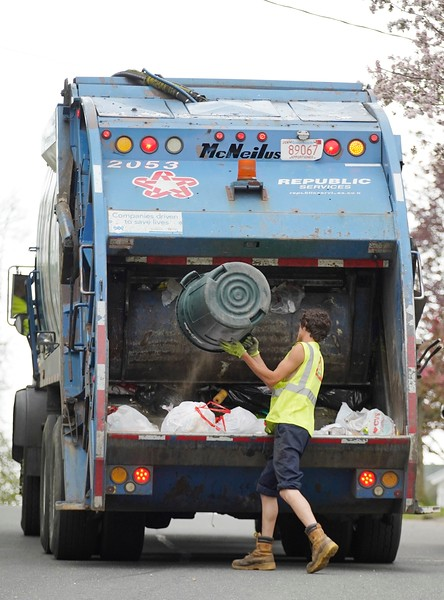 BEN GARVER — THE BERKSHIRE EAGLE<br /> A Republic Services worker collects garbage on Dewey Ave in Pittsfield.
